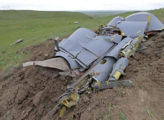 Wreckage from an Air Force KC-135 tanker is strewn across a field near the village of Chaldovar, about 100 miles west of the Kyrgyz capital Bishkek, on May 3. (Vladimir Voronin / The Associated Press)