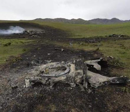 Wreckage from a U.S. Air Force KC-135 tanker aircraft wreckage is seen in a field near the village of Chaldovar, about 100 miles west of the Kyrgyz capital Bishkek, on May 3. (Vladimir Voronin / The Associated Press)