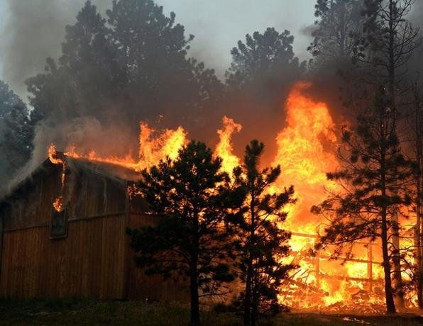 A structure off of Herring Road burns out of control in the midst of the Black Forest Fire in Colorado Springs, Photo Credit: Helen H. Richardson/The Denver Post, Photo Date: June 11th, 2013