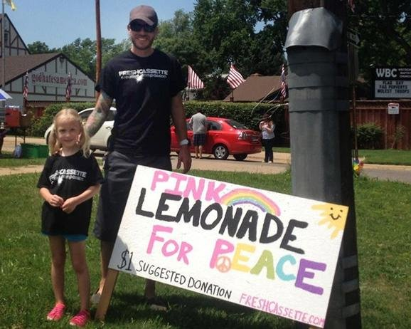 Jayden Sink, 5, and her father, Jon Sink, set up a lemonade stand at Equality House on Friday, across the Street from Westboro Baptist Church. The money she raised will go to the organization that founded Equality House, Planting Peace.
