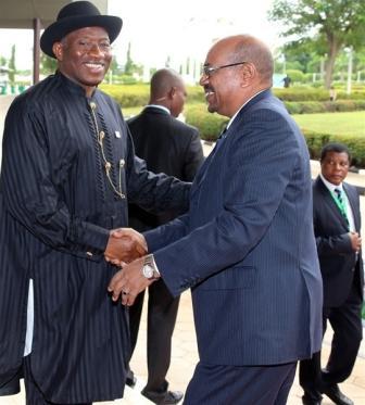 Sudanese President Omar al-Bashir on the right