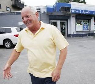 Stephen Rakes smiles after greeting an acquaintance outside the liquor store he once owned in the South Boston neighborhood of Boston. Rakes was found dead Wednesday in a Boston suburb.