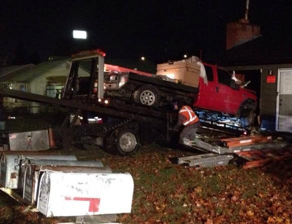 Three people were injured after a man crashed his truck through a house in Coeur d'Alene