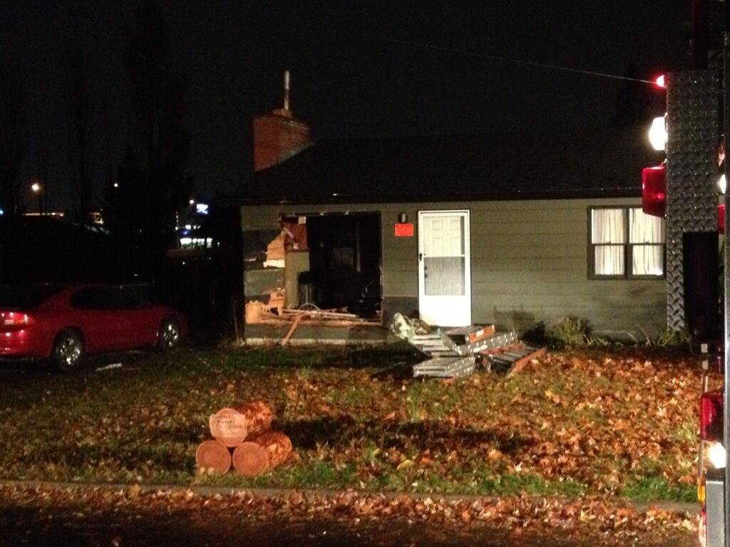 Coeur d'Alene Police arrested 27-year-old  Thomas Scott Heinbaugh after he allegedly crashed his pickup through this house in Coeur d'Alene