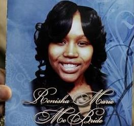 A mourner holds a picture of 19-year-old shooting victim Renisha McBride during her funeral service in Detroit on Nov. 8.