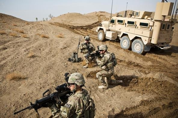 U.S. Army soldiers with Charlie Company, 36th Infantry Regiment, 1st Armored Division set up a supportive position during a mission near Command Outpost Pa'in Kalay in Maiwand District, Kandahar Province in February.