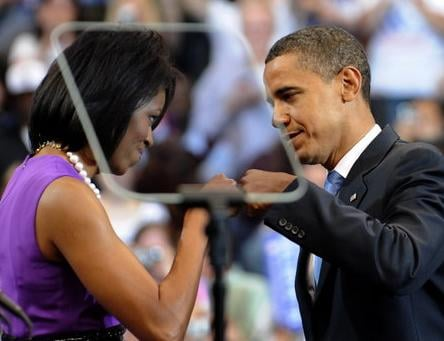 "Michelle Obama & President Barack Obama giving each other the ""fist bump."""