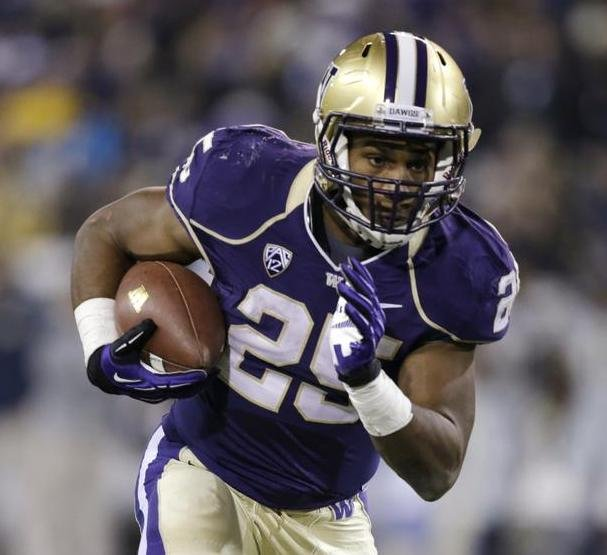 Washington's Bishop Sankey carries on a three-yard touchdown run against California Saturday, Oct. 26, 2013, in the first half of an NCAA college football game in Seattle. (Photo courtesy the Spokesman Review)