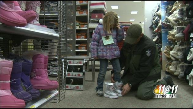 Several kids had the opportunity to go Christmas shopping with Deputies Wednesday afternoon in Spokane Valley at Target