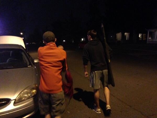 Gonzaga Students Dan McIntosh and Erik Fagan retrieve their guns from the Gonzaga Security building