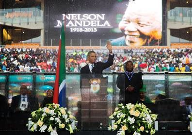 President Obama addresses the crowd at Mandela's memorial.