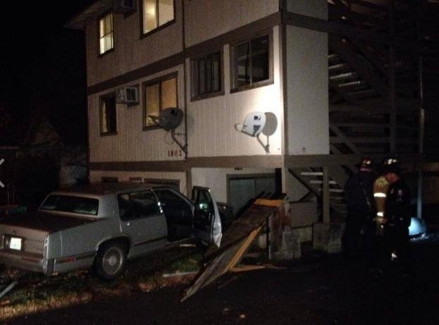A driver was taken into custody after he crashed into an apartment, according to Spokane Police.