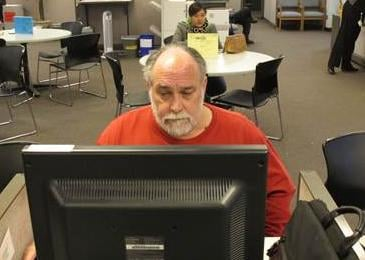 Richard Mattos, 59, looks for jobs at a state-run employment center in Salem, Ore., on Thursday, Dec. 26, 2013. Mattos is one of more than 1 million Americans who will lose federal unemployment benefits at year's end.