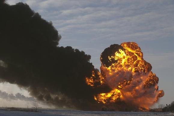 A fireball erupts at the site of an oil train derailment on Monday in Casselton, N.D.