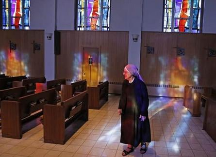 Mother Patricia Mary walks in the chapel at the Mullen Home for the Aged, run by Little Sisters of the Poor, in Denver. The group wants relief from the Affordable Care Act's birth control mandate.