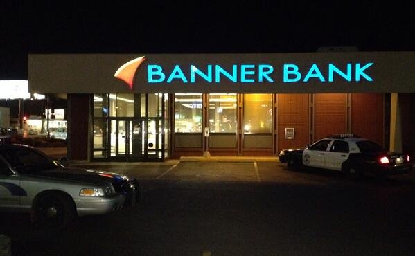 Police investigate a robbery at Banner Bank in north Spokane Thursday night