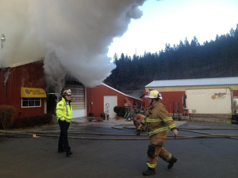 A huge plume of smoke and steam rose above a barn in northeast Spokane Wednesday morning as a fire ripped through it, destroying Spokane business Bullseye Amusements' arcade games and carnival memorabilia.