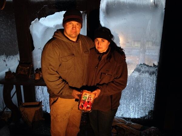 Rachelle Flatt and her husband stand in their home that was destroyed by a fire on Tuesday night