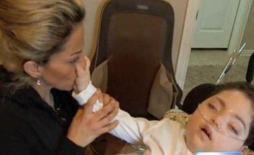 Loubna Khader with her son who now needs 24-hour care.