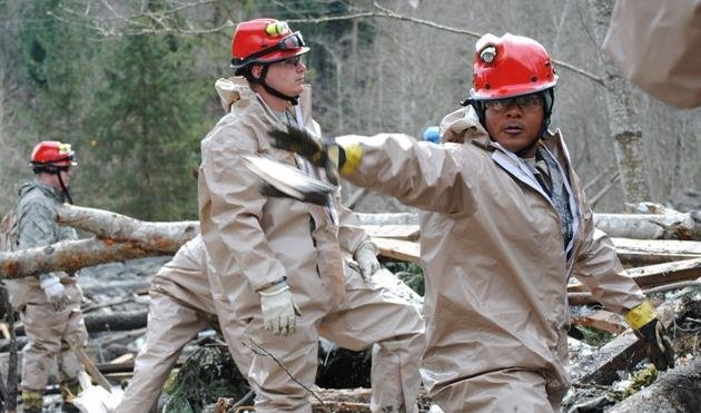 PHOTO: Rescue workers removing debris on the west side of the Oso Mudslide on State Route 530., Photo Credit: Washington National Guard, Photo Date: March 26, 2014