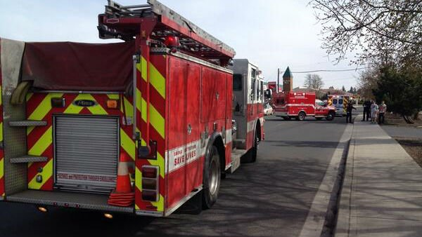 Firefighters tend to a 92-year-old woman who was hit on the south hill near 44th and Regal Monday afternoon