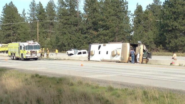 After hitting the barrier, the pickup the RV was towing was thrown into oncoming traffic. No one was seriously hurt.