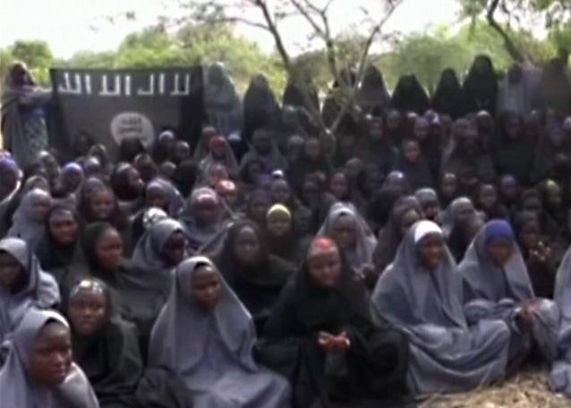 New video from Nigeria's Boko Haram terrorist network purports to show dozens of abducted schoolgirls, covered in jihab and praying in Arabic.