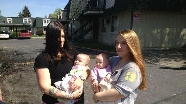 A fire ripped through the Pine Villa Apartment building on Graves Road in North Spokane Sunday, displacing several families, including Amanda Haggard and her 6-month-old twin daughters.