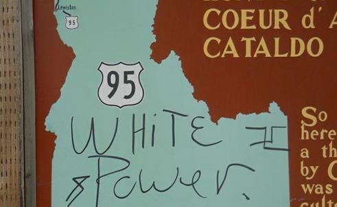 © Historical marker on the Coeur d'Alene Indian Reservation defaced with racist graffiti. This photo has been cropped.