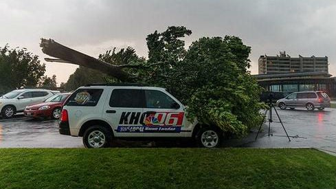 No one was injured when a tree fell on a KHQ car in Coeur d'Alene after a violent storm