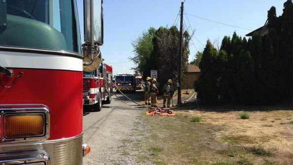 Firefighters put out a house fire in Spokane Valley next to I-90 on Monday morning