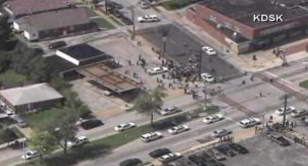 Aerial footage from KDSK showing a crowd forming around the scene of an officer-involved shooting near Ferguson