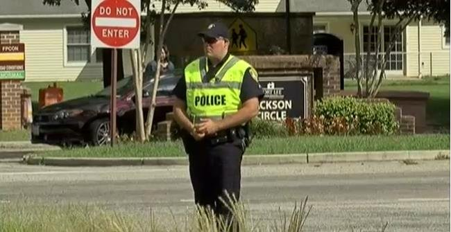 Police officer patrols the entrance of Fort Lee in Virginia