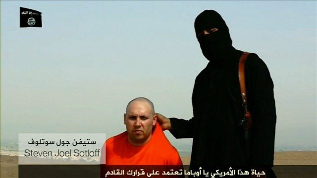 Screenshot from an ISIS video posted online shows captured American journalist Steven Joel Sotloff, Photo Credit: ISIS Video