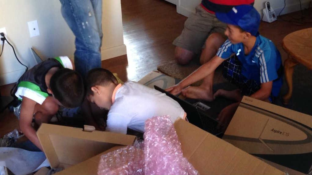 KHQ's Gabe Cohen received a package from Kansas City, sent from a man touched by the boys' efforts. In the package were four laptops, exactly what they had been working so hard to buy.