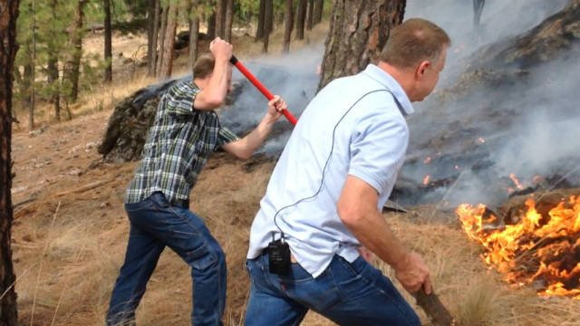 Pastors Jeremy Hayak and Ben Orchard were the first two to run up the hill and help put a line around the fire.