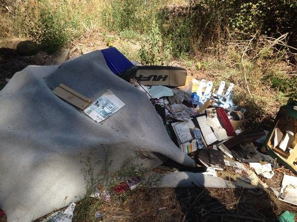 Family helps man clean up illegal dumping in Spokane