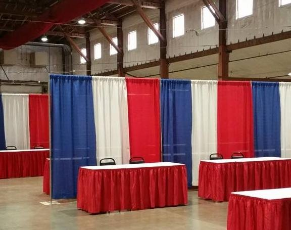 Organizers setting up for the Hometown Heroes job fair at the Spokane Co. Fair & Expo Center