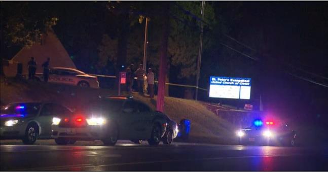 Scene outside community center in Ferguson where a police officer was shot