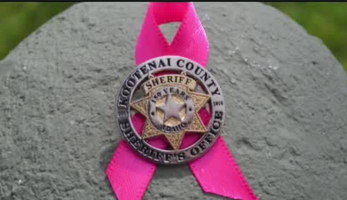 Kootenai County Sheriff's deputies wearing pink ribbons with badges