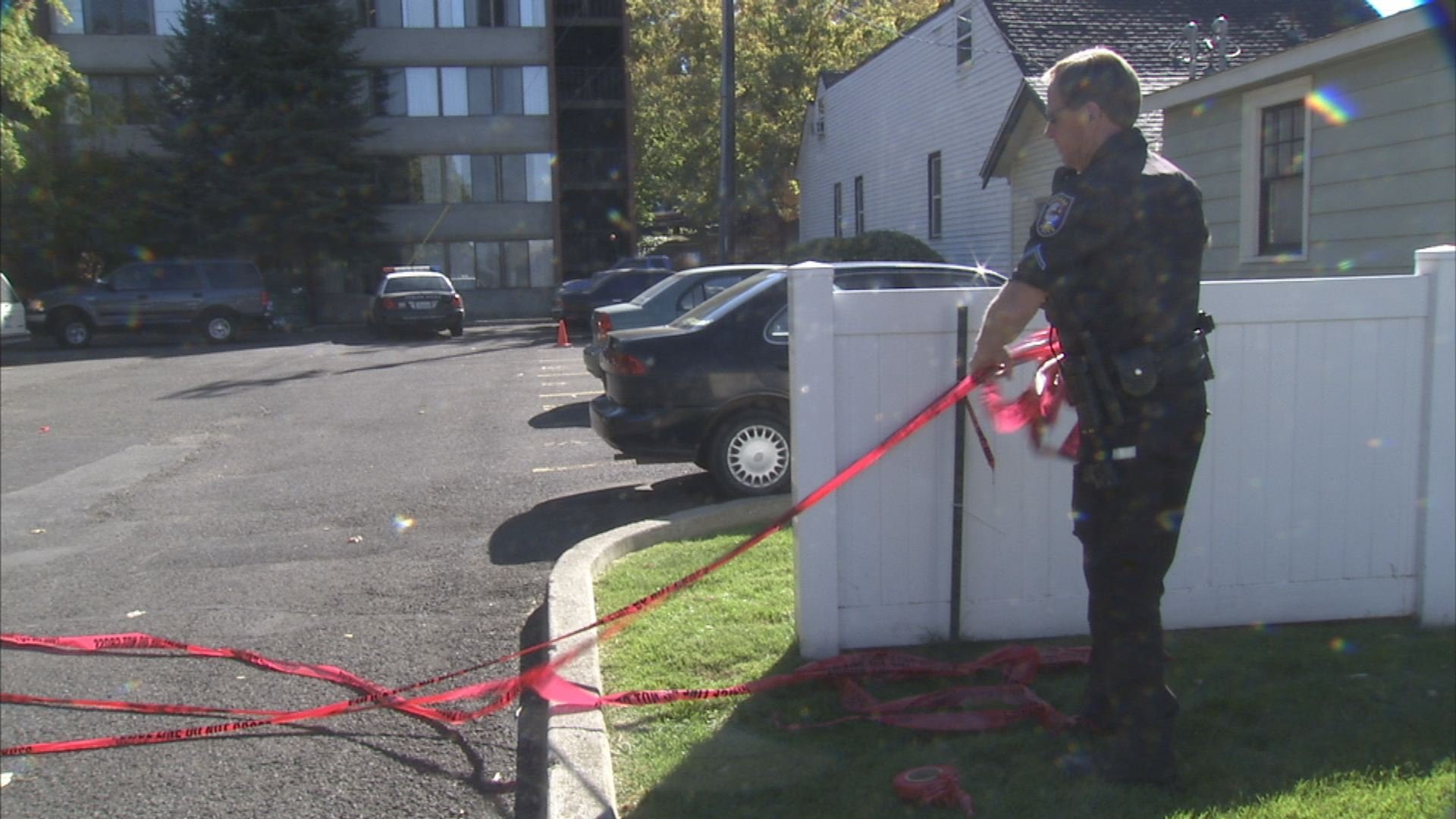 Detectives investigate the scene where Richard Whipple was found dead in his Browne's Addition apartment