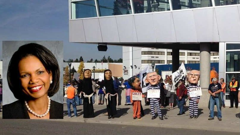 Protesters gathered outside the Convention Center on Thursday as Former Secretary of State Condoleezza Rice spoke at the President's Leadership Forum inside.