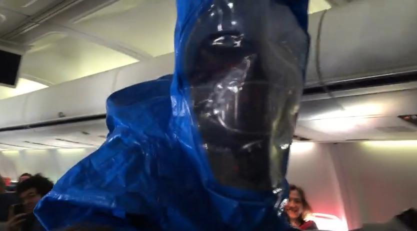People in hazmat suits board plane after Ebola joke