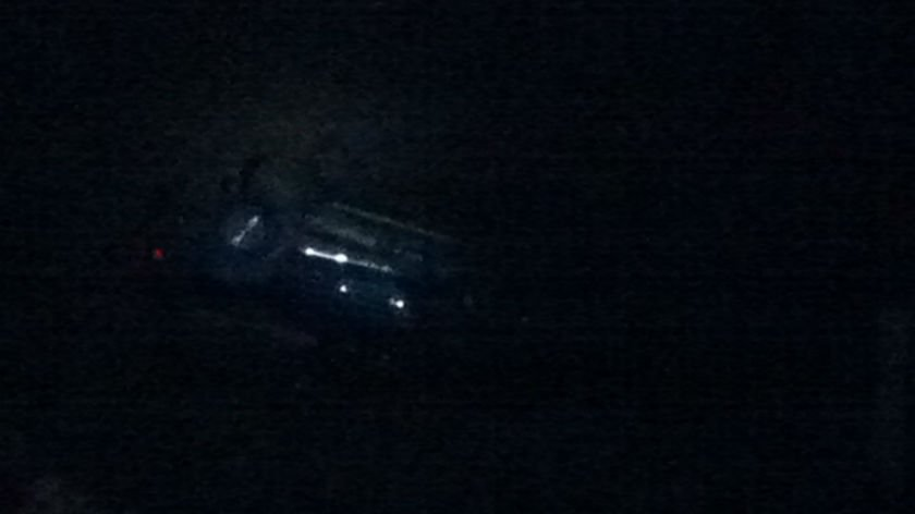 A car rolled down an embankment about 100 feet near Maple and Francis on Wednesday