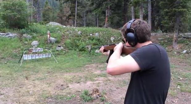 A man plays the Star-Spangled Banner by shooting steel targets with a rifle. (PHOTO: YouTube/Musical Targets)