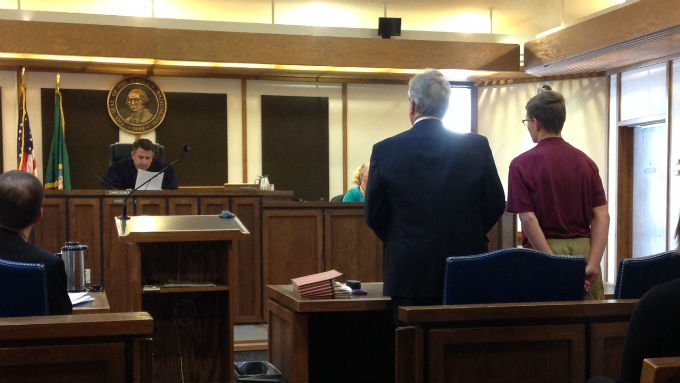 The 16-year-old suspect stands before a judge to face arson charges.