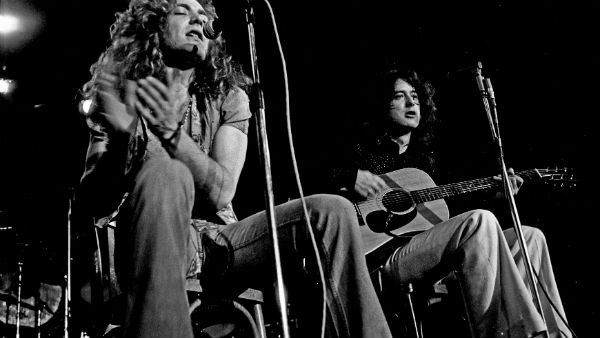 Cropped photo of Robert Plant and Jimmy Page in concert uploaded to Flickr by Heinrich Klaffs CC by S.A. 2.0