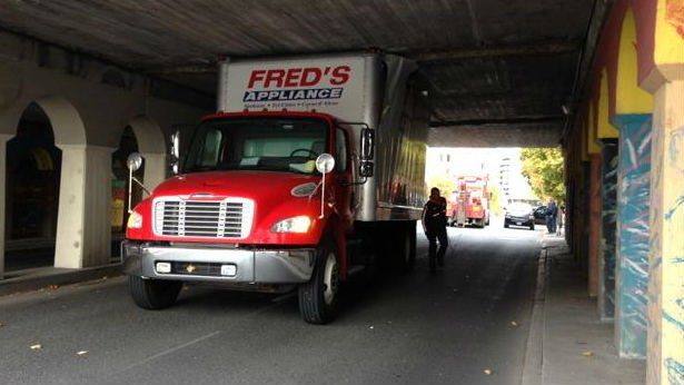 An appliance delivery truck was stuck under an overpass in downtown Spokane on Wednesday