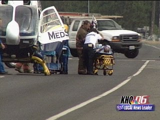 The suspect in a car chase is wheeled into a medical helicopter after crashing his vehicle at Highway 2 and Day-Mt. Spokane Road