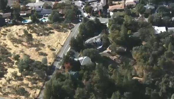 A sheriff's spokeswoman says an assailant has shot two sheriff's deputies in Northern California after shooting an officer and a bystander in a neighboring county.